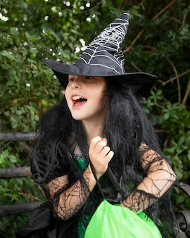 Kid in cute but scary witch costume