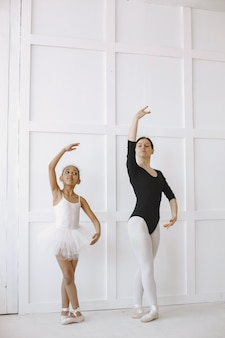 . kid in dance class with teatcher