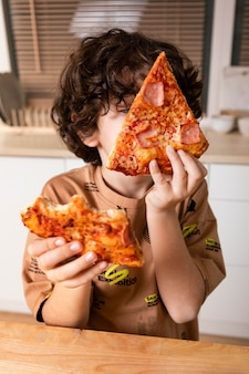 Kid eating pizza at home