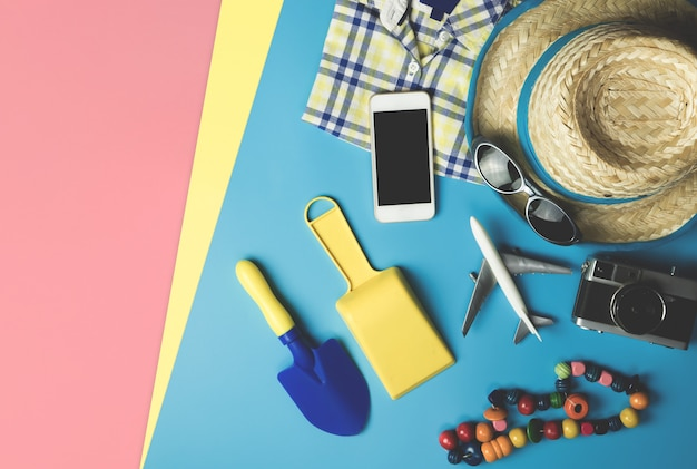 Kid fashion and beach accesories flatlay for summer vacation theme