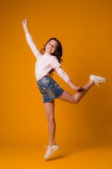 Kid girl jumping happy girl dancing