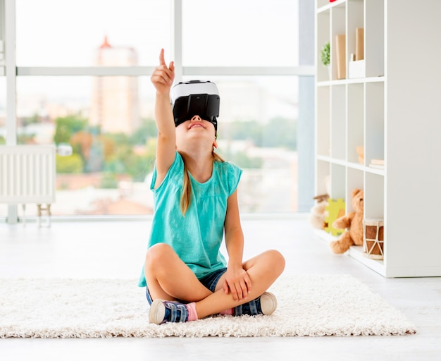 Kid girl playing games in vr headset