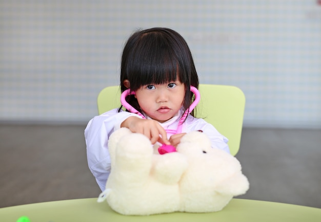 Kid girl plays doctor