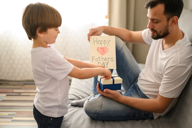 Kid giving present to his dad