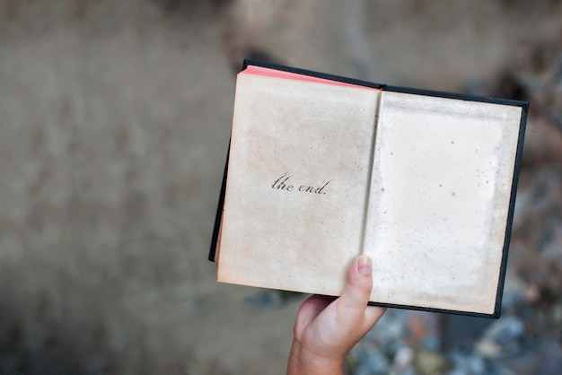 Kid hand open old book story