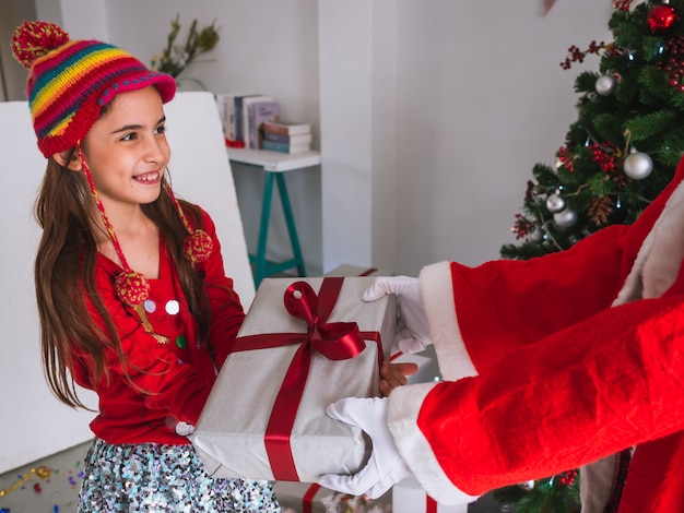 Kid happy to receive gifts from santa claus