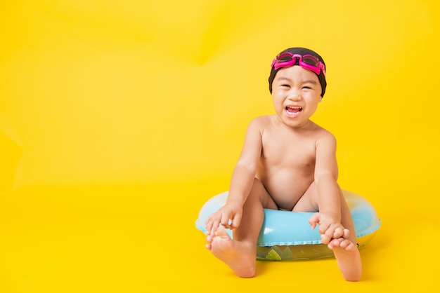 Kid hav fun sit in inflatable