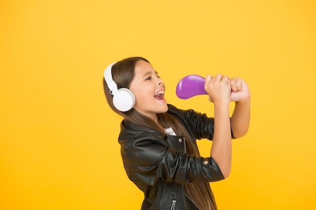 Kid in headset small girl sing favorite song imagine you are pop star singing karaoke singer