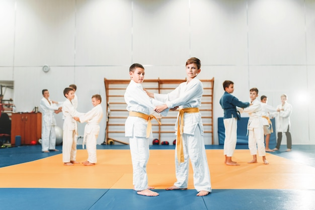 Kid judo, childrens training martial art in hall