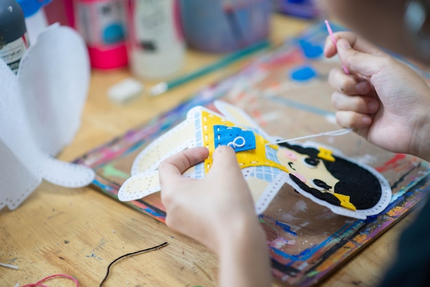 Kid learning art painting and crafting in the art classroom