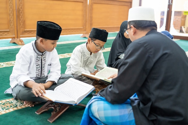 Kid learning to read quran