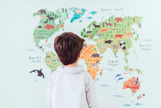 Kid looking at world map