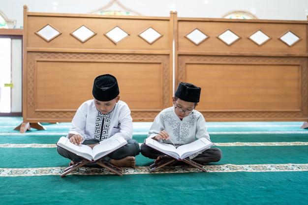 Kid muslim reading quran