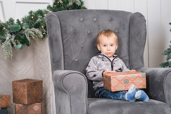 Kid on couch with gift