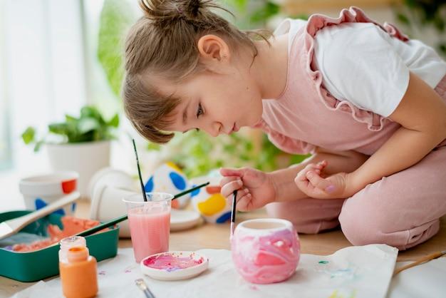 Kid painting plant pot diy hobby