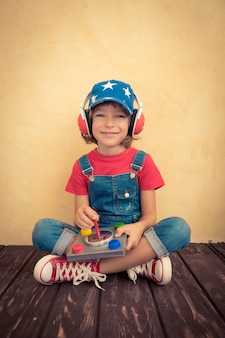 Kid pilot playing at home. success and innovation concept