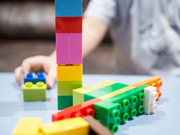 Kid playing with color toy blocks