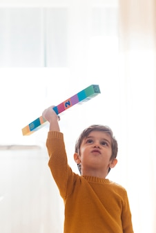 Kid playing with cubes