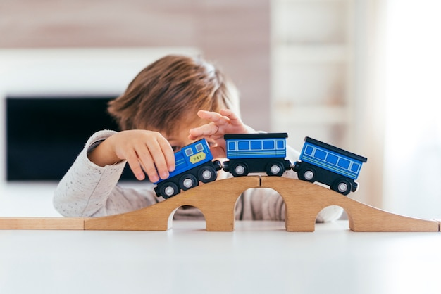 Kid playing with toy train