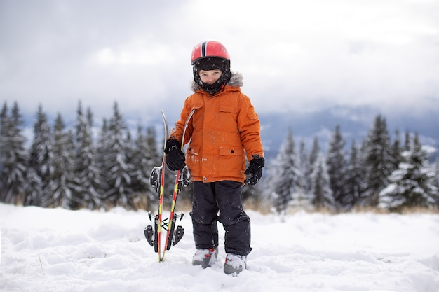 Kid posing with ski gear in the snow