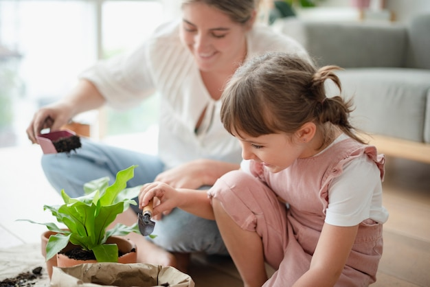 Kid potting plant at home as a hobby