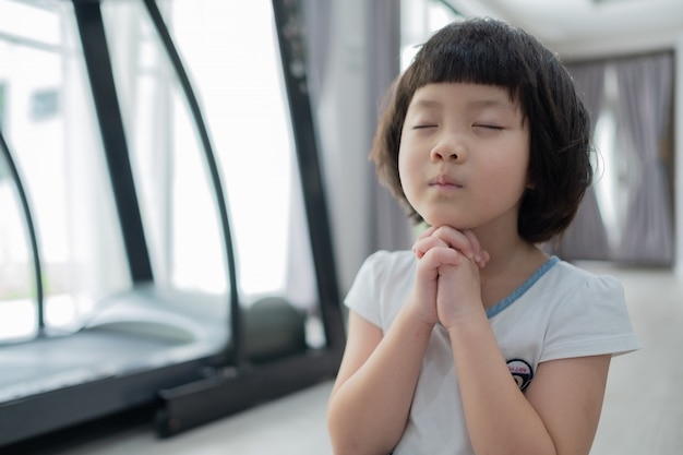 Kid praying in morning