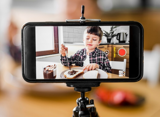 Kid recording himself with phone