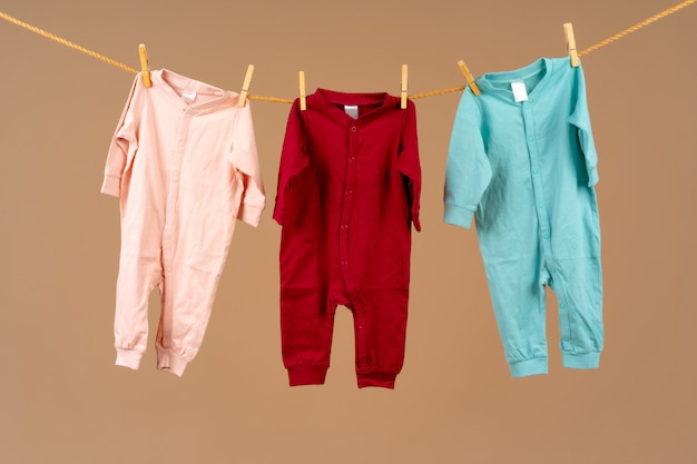 Kid's apparel pinned to a clothesline to dry