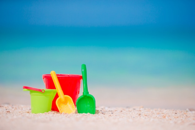 Kid's beach toys on white sand. buckets and blades for kids on the white sandy beach after children's games