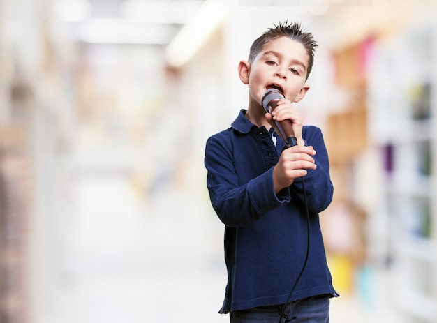 Kid singing with blurred background