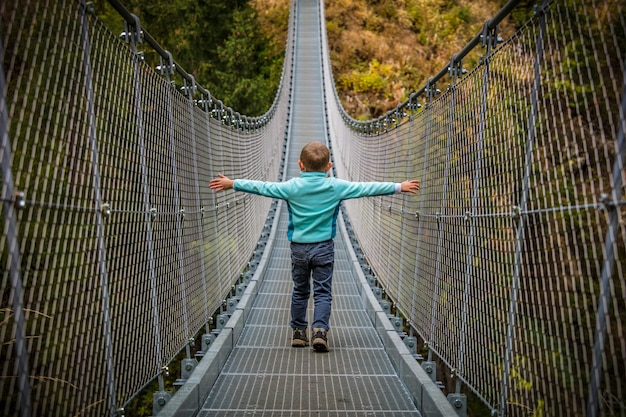 Kid on suspended bridge
