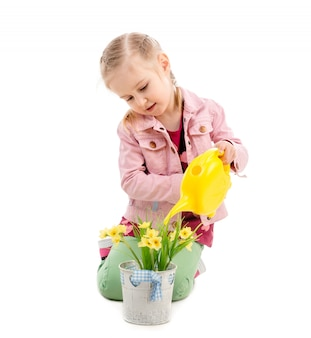 Kid watering flowers, isolated on white background