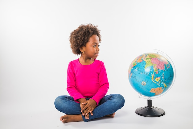 Kid with globe in studio