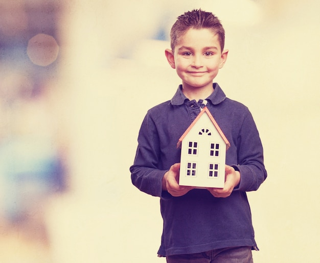 Kid with a house