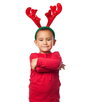 Kid with plush reindeer antlers