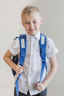 Kid with rucksack in studio