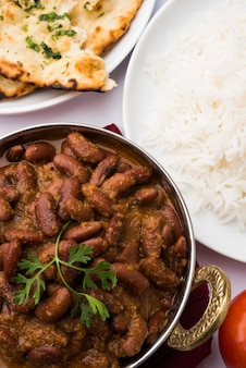 Kidney bean curry or rajma rice or rajmah chawal and roti, typical north indian main course, selective focus