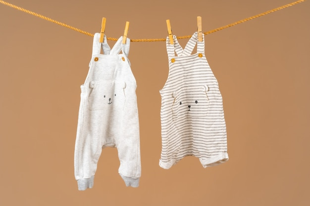 Kids apparel pinned to a clothesline to dry