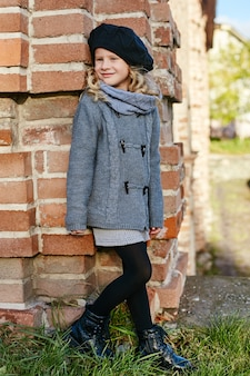 Kids baby in retro autumn spring clothes.