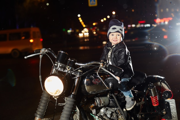Kids bikers on a motorcycle ride through the city