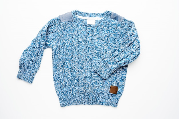 Kids blue knitted sweater isolated. front view