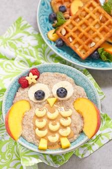 Kids breakfast porridge with fruits