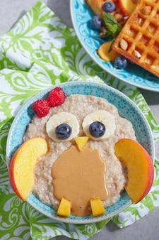 Kids breakfast with porridge and fruits