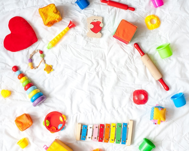 Kids bright colorful toys frame on white background. top view. flat lay. copy space for te
