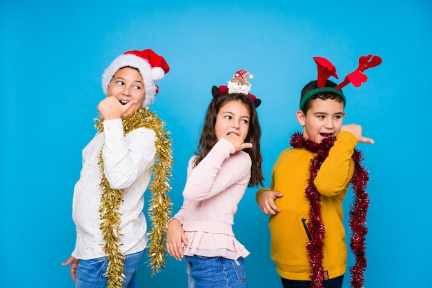 Kids celebrating crhistmas day doing expressions