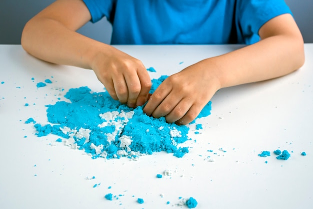 Kids creativity. kinetic sand games for child development at home. sand therapy.