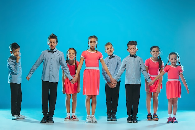 The kids dance school, ballet, hiphop, street, funky and modern dancers on blue studio