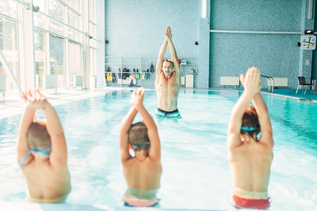 Kids doing exercise in swimming pool