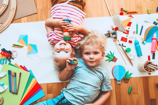 Kids draw and make crafts children with educational toys and school supplies for creativity