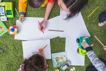 Kids drawing and playing
